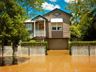 Queenslander house surrounded by flood water