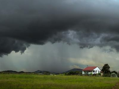 Farm house under stormy sky