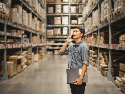 Man in warehouse on mobile phone